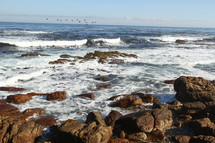 Ocean waves crashing against a rocky shore.