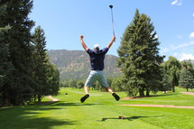 Man celebrating on the golf course
