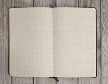 graph paper in a notebook