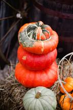 wagon wheel and stacked pumpkins