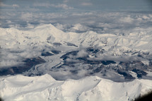 aerial view over snow capped mountains