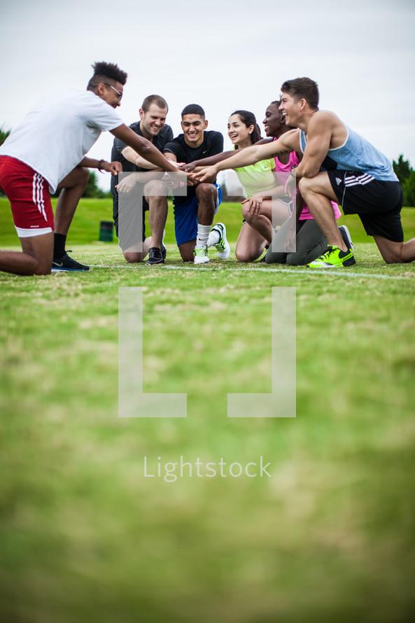 all hands in, team cheer, team prayer