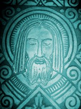 Stone etching of the face of Jesus Christ created in the style of early Aztec art.