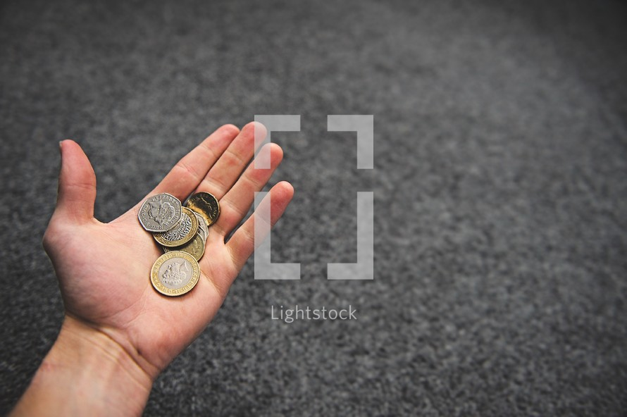 coins in a hand