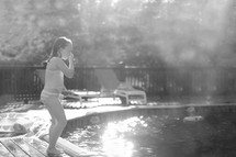 a child about to jump into a pool
