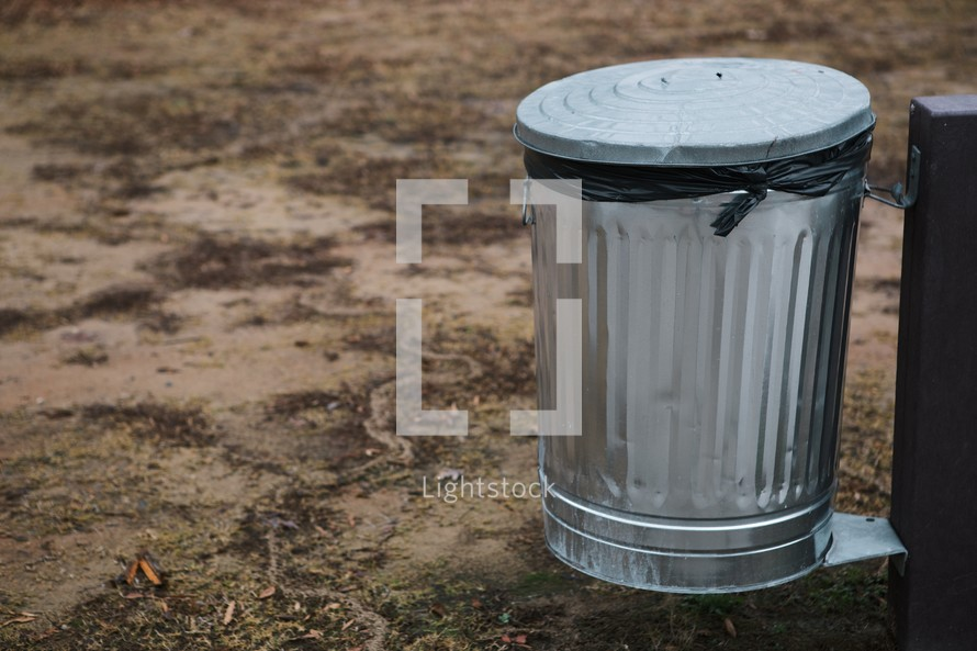 Metal trash can.
