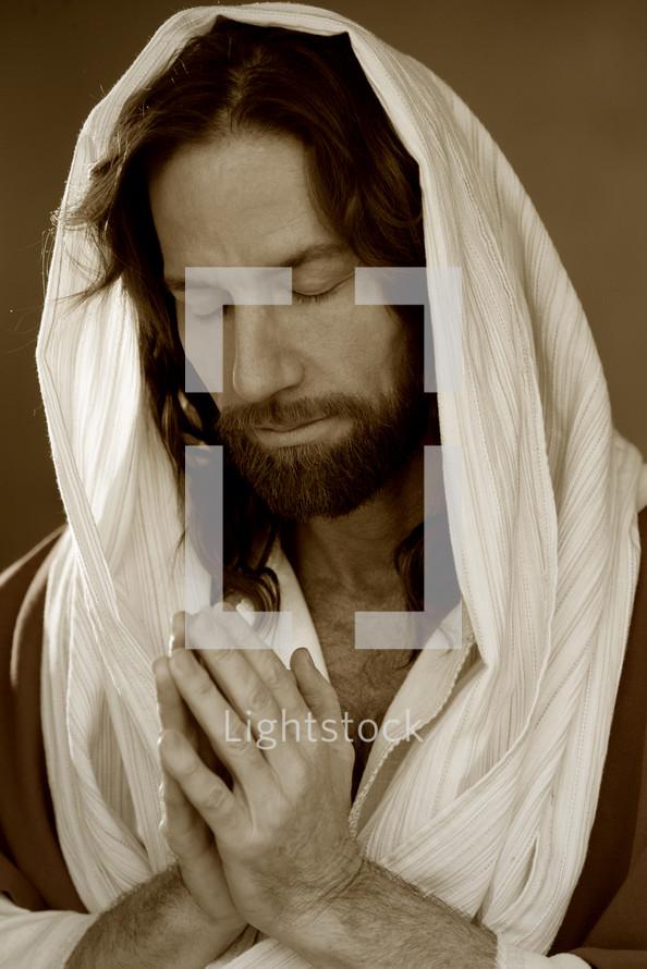 Shrouded Jesus in prayer.