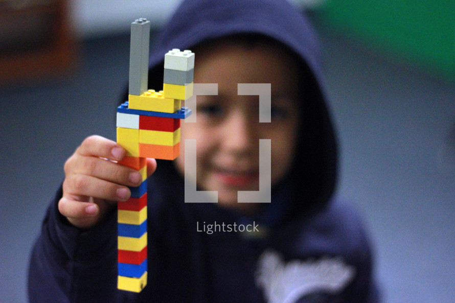 Boy playing with legos.