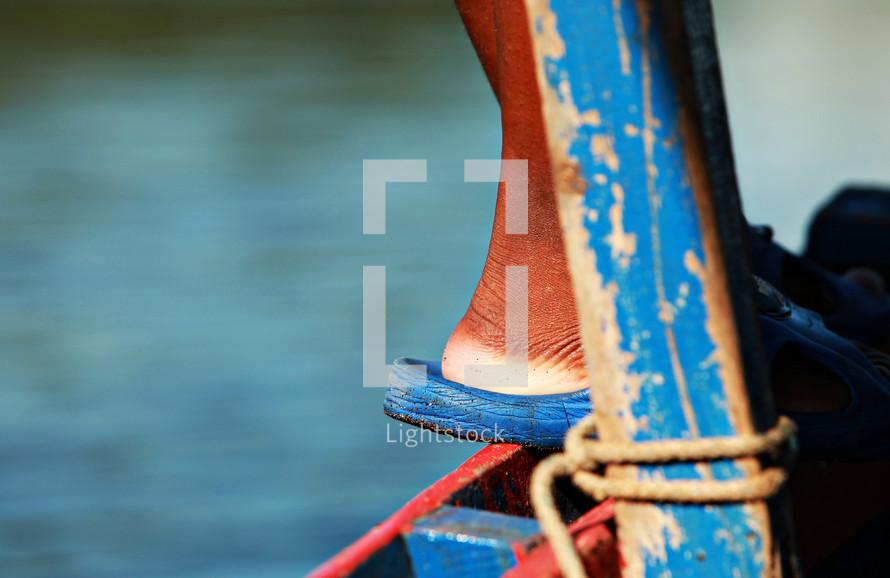 feet standing on a dock