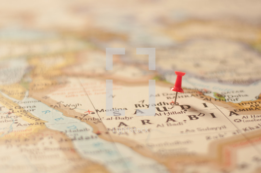 thumbtack on a map of Saudi Arabia