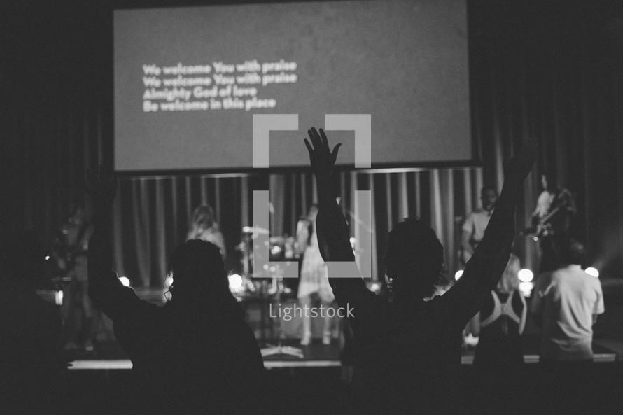 worshipers singing at a worship service