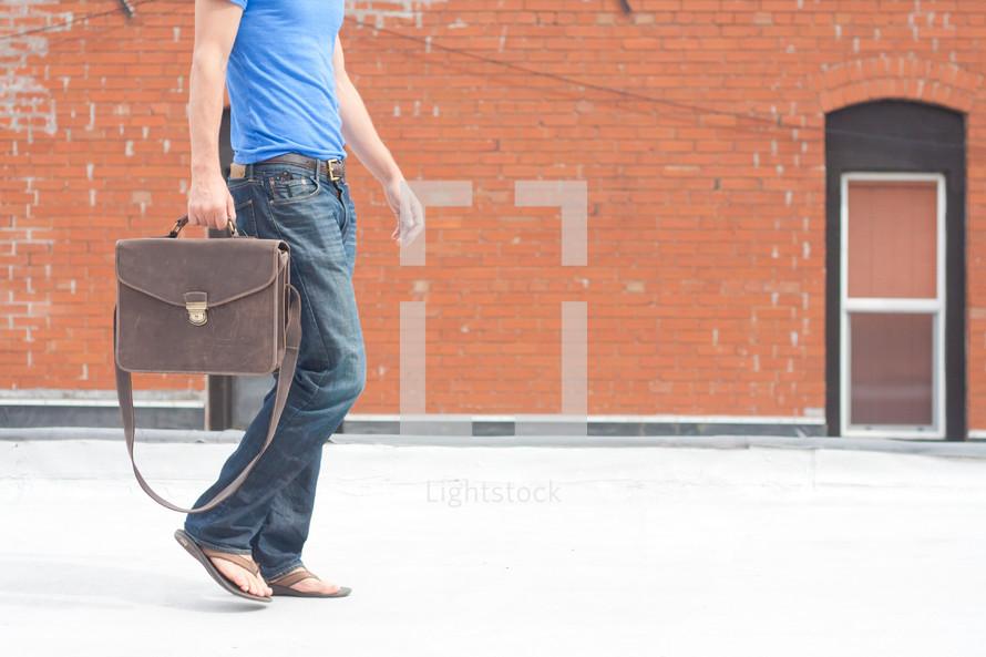 man with a man bag