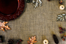 a fall table setting with decor in a border