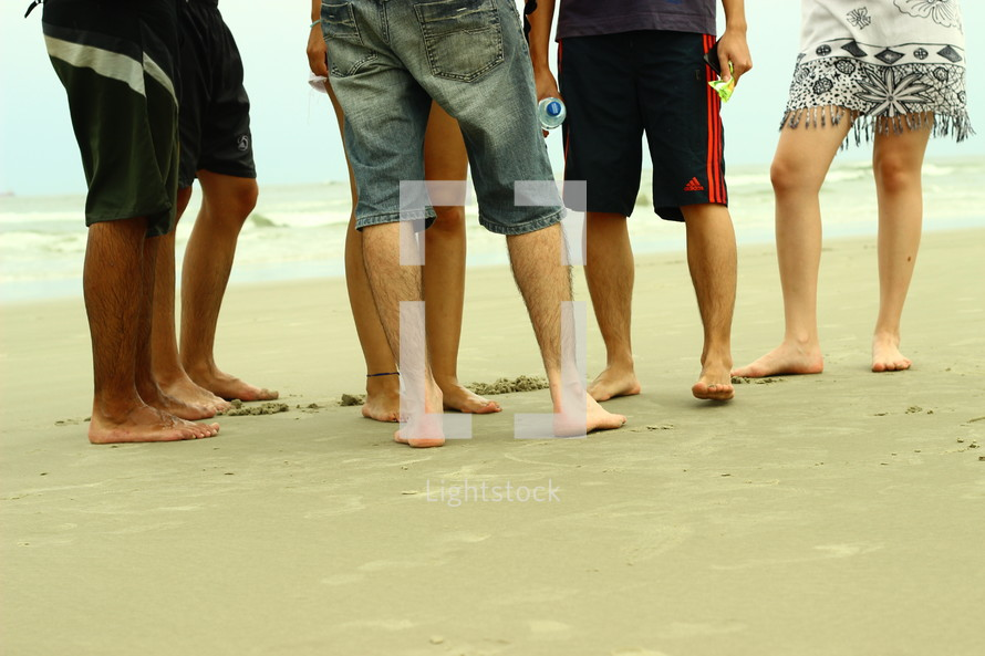 bare feet in the sand.
