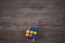 A rubik's cube on wood
