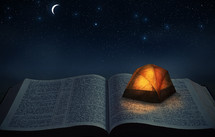 a tent on an open Bible