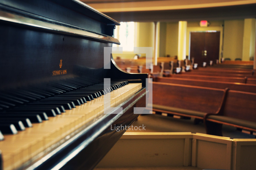 piano keys and rows of church pews