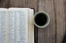 coffee cup and open Bible