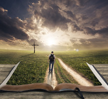 man walking down a path over the pages of a Bible