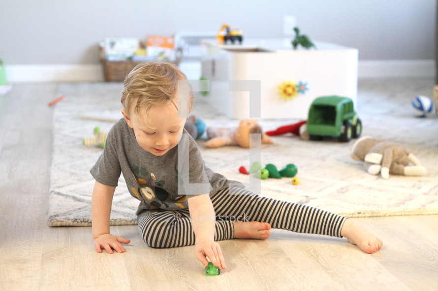 toddler boy playing with toys