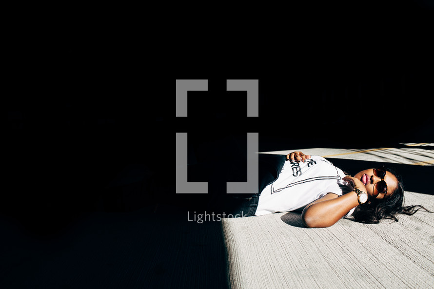 woman lying on a porch in sunlight