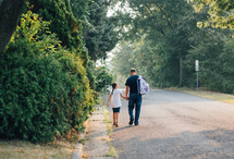 father and daughter walking to the bus stop