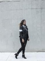 portrait of a woman standing on a sidewalk