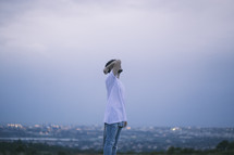 a man looking up with a city behind him