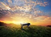 manger on a hill at sunrise