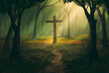 cross at the end of a path in a forest
