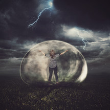 woman in a protective bubble in a thunderstorm