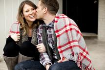 man kissing a woman on the cheek