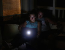 a couple looking at a computer screen