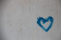 Blue heart graffiti on a concrete wall