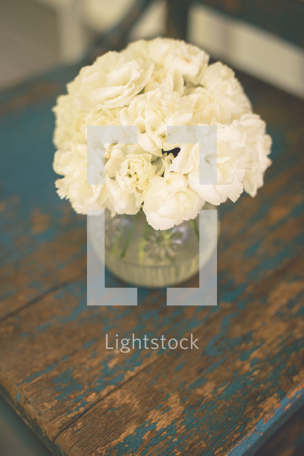 vase of white carnations