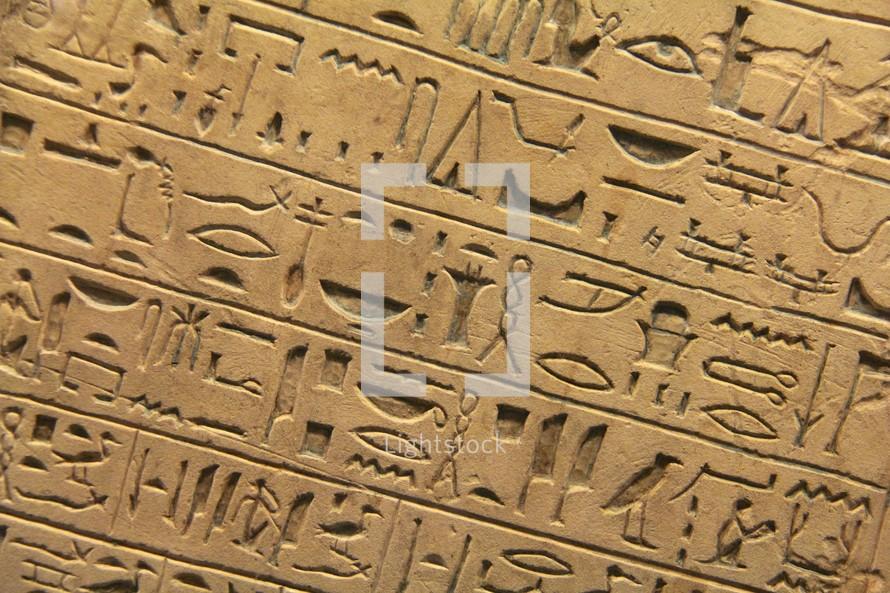 Egyptian hieroglyphics set in clay