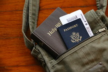 Mission trip, passport, sling bag, air ticket and Bible on a wooden background