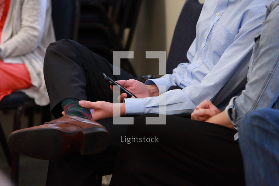 Man reading the Bible app on his cell phone during Bible study.