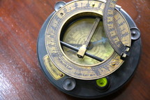 Magnetic compass showing direction, orientation, level and angle of the sun