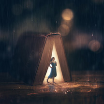 woman standing under a Bible in pouring rain