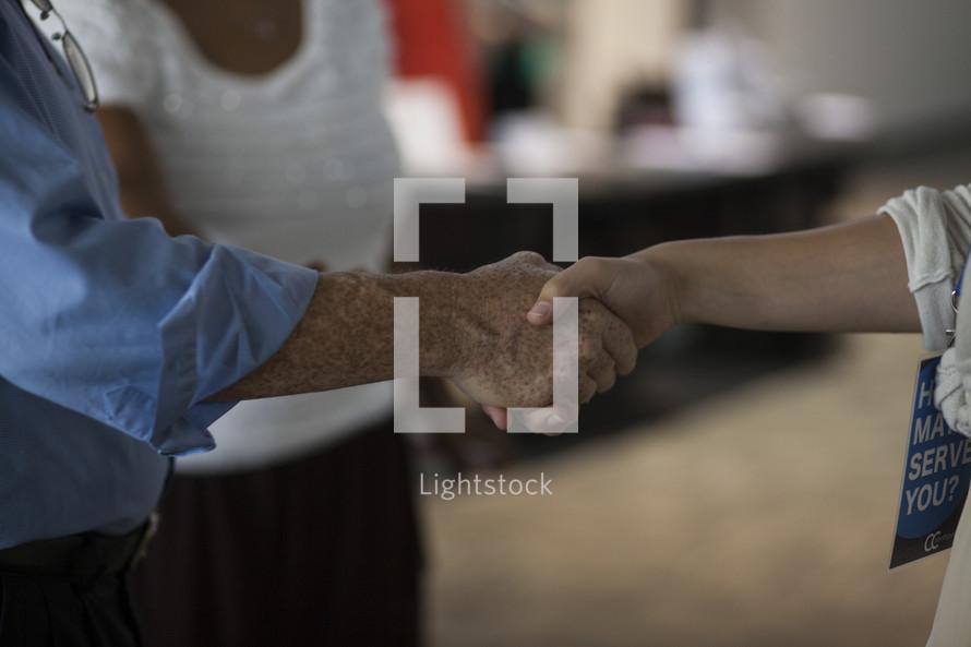 Shaking hands.