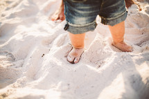 Toddler's feet in the sand.