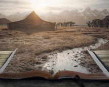stream flowing into an open Bible and barn