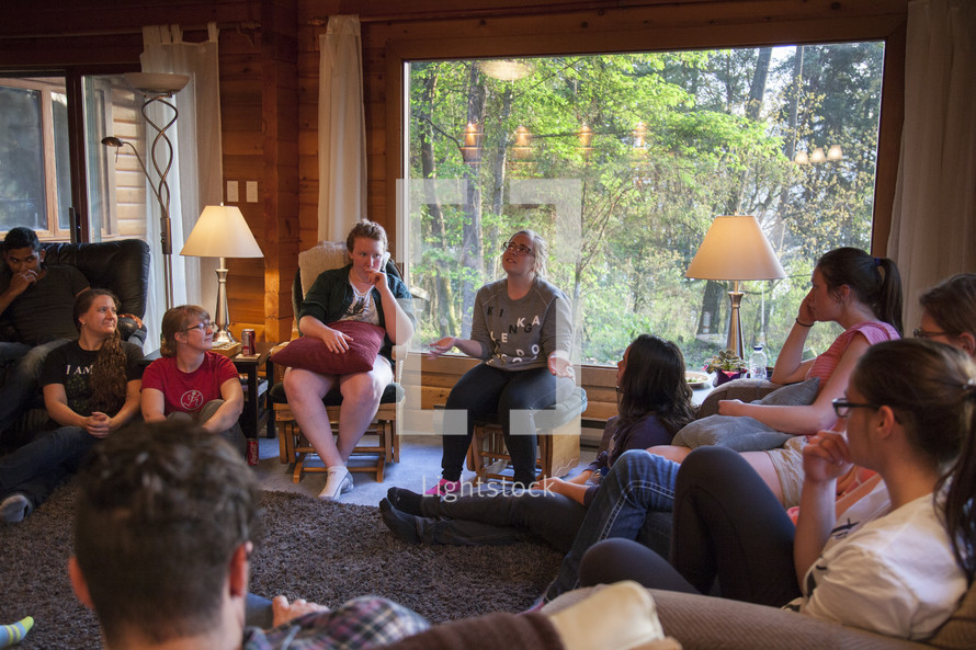 people sitting around having a discussion at a retreat
