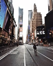 man riding a bicycle through Times Square