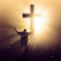 silhouette of a man in front of a glowing cross with his hands raised in praise