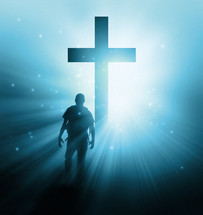 man with a back pack walking towards a glowing cross