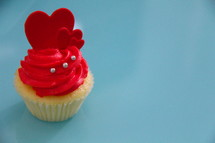 Valentine's day cupcake with frosting and red hearts