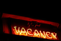 "Illuminated ""vacancy"" sign."
