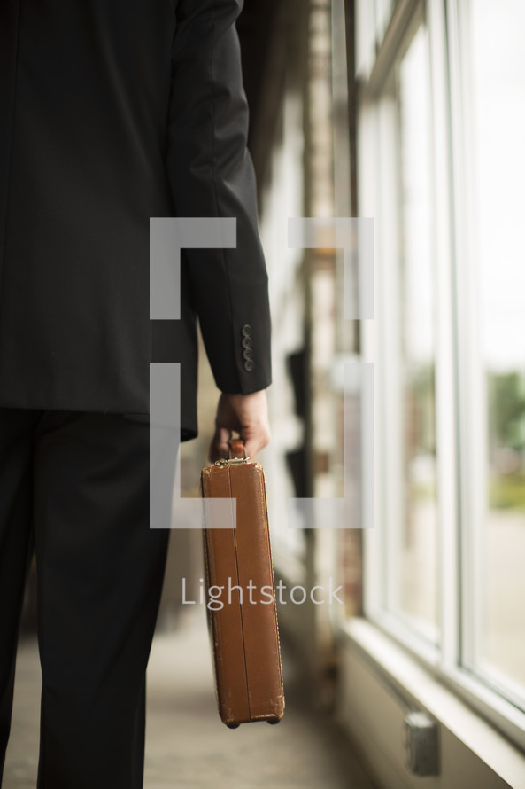 businessman carrying a briefcase ready for a meeting.